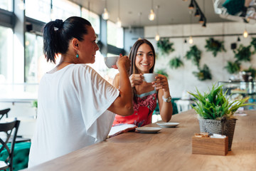 Two women drinking coffee in a cafe
