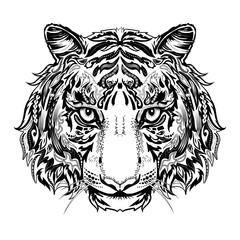 Tiger head black and white silhouette with ornament isolated on white. It can be used for printing on t-shirts or coloring books.