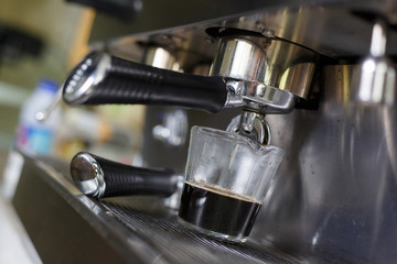 coffee making process from coffee machine in cafe shop