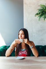 Portrait of woman in a cafe