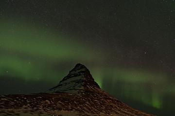 Northern Lights swirling around Kirkjufell, Iceland