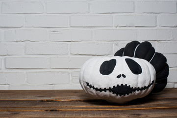 Black and white pumpkins. Home decoration for Halloween.