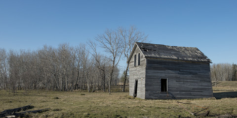 Old abandoned barn in a field, Manitoba, Canada