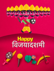 happy dussehra or happy vijayadashmi or happy aayudha pooja greeting card made using a photograph of colourful clay models of king ravana and ancient indian armour used in Ramayana and Mahabharata