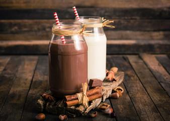 Acrylic Prints Milkshake Chocolate and vanilla milkshake in the glass jar