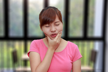 Woman hands touching her own cheek or having toothache - dental