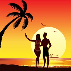 selfie makes lovers on the beach, sunset