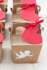 Valentine's Day gift boxes on a light wood tabletop