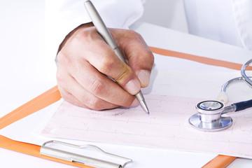 Doctor examining cardiogram