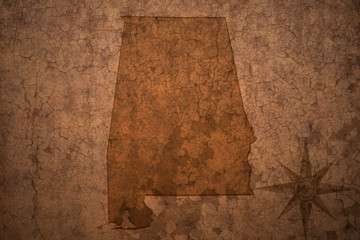 alabama state map on a old vintage crack paper background
