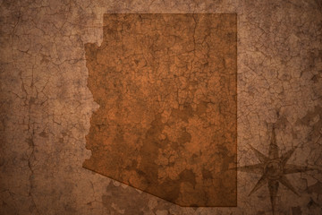 arizona state map on a old vintage crack paper background