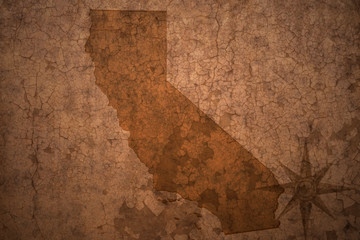 california state map on a old vintage crack paper background