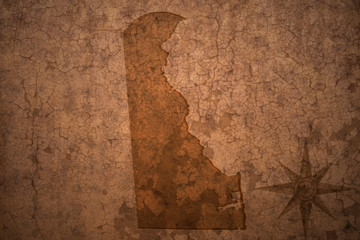 delaware state map on a old vintage crack paper background