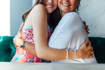 Embrace of mother and daughter