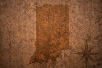 indiana state map on a old vintage crack paper background