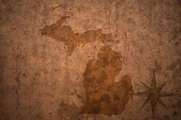 michigan state map on a old vintage crack paper background
