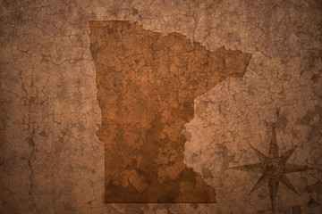 minnesota state map on a old vintage crack paper background