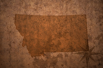 montana state map on a old vintage crack paper background