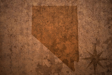 nevada state map on a old vintage crack paper background