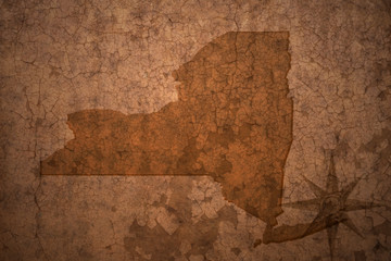 new york state map on a old vintage crack paper background