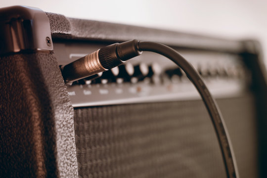 Guitar amplifier with cord plugged in