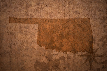 oklahoma state map on a old vintage crack paper background