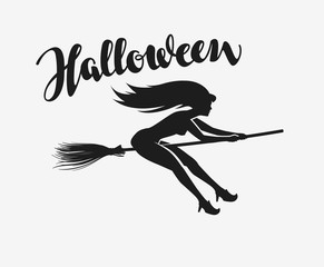 Halloween. Silhouette beautiful young witch flying on a broomstick