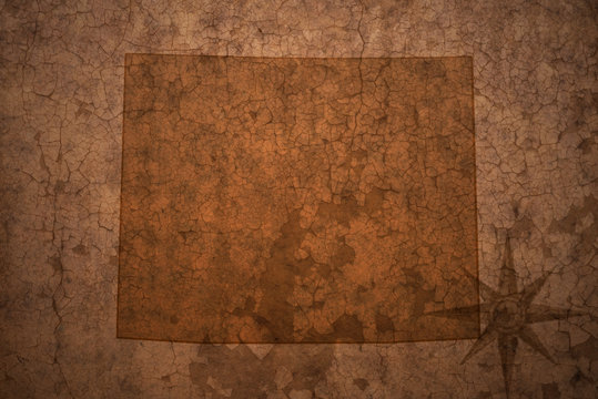 wyoming state map on a old vintage crack paper background