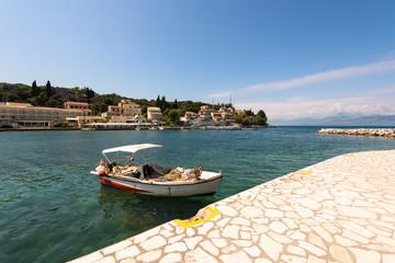 Typical fishing boat on sunny day in Kassiopi port. Corfu Island. Greece.