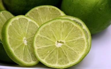 Lime or lemon with some slice on white plate
