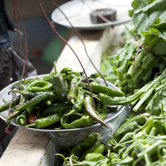 Bowl of green chili peppers at the vegetable market in Thimphu, Bhutan