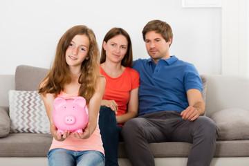 Girl Holding Piggybank