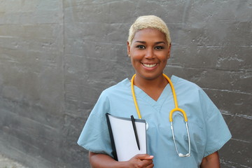 African female doctor isolated on gray