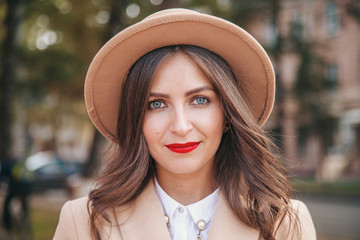 portrait of a girl with red lipstick wearing  hat and coat