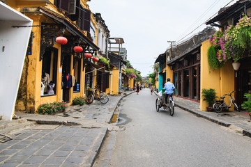 Cyclo in Hoi An Ancient Town, Quang Nam, Vietnam. Hoi An is recognized as a World Heritage Site by UNESCO.