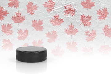 Hockey puck and maple leaves