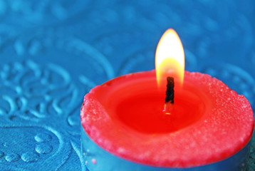 candle on blue background for Diwali cards and wishes