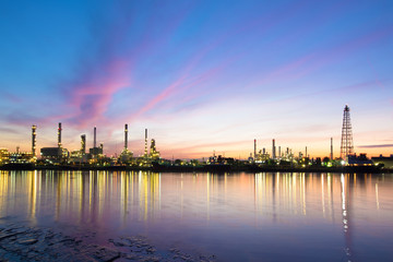 Refinery with tube and oil tank along twilight sky at beautiful