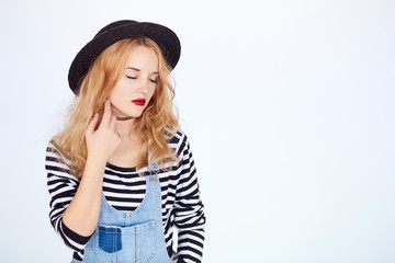 hipster young woman in trendy clothes dreaming
