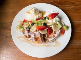 Mixed fruits waffle with ice cream