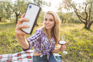 Young Woman Taking Selfie on Mobile Phone while Drinking Red Win
