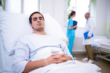 Ill patient lying on bed