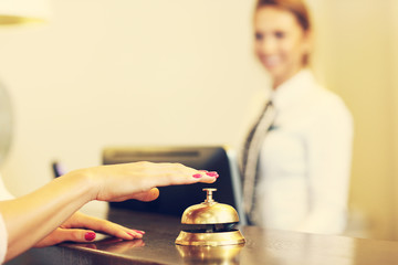 Guest using reception bell in lobby