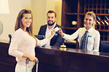 Woman at reception desk in hotel