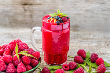 Raspberry cocktail in a glass jar, drink with fresh berries