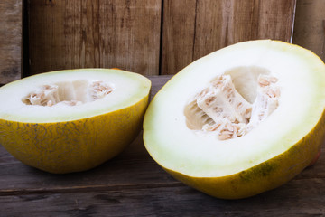 Sliced melon with on rustic wooden background
