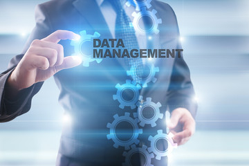 """Businessman is selecting """"Data management"""" on the virtual screen."""