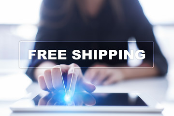 """Woman is using tablet pc, pressing on virtual screen and selecting """"Free shipping""""."""