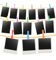 three rows with photo frames hanging on a rope with clothespins