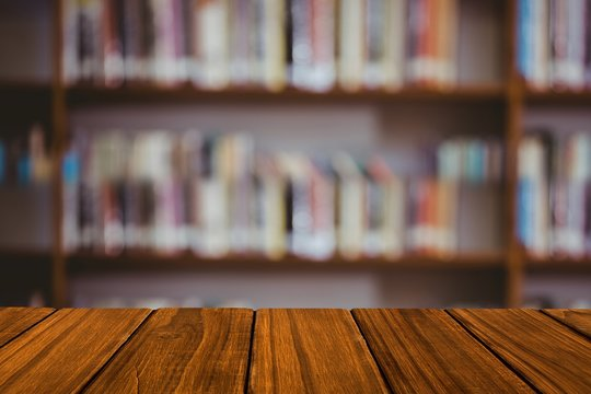 Wooden table with library background